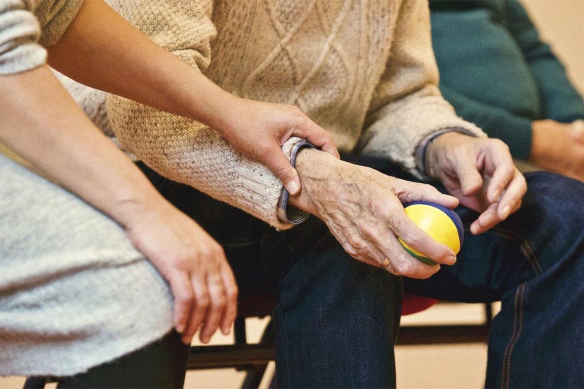 woman comforting elderly man
